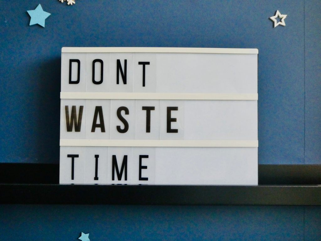 Lightbox Quote displaying message Don't Waste Time with navy blue background and stars