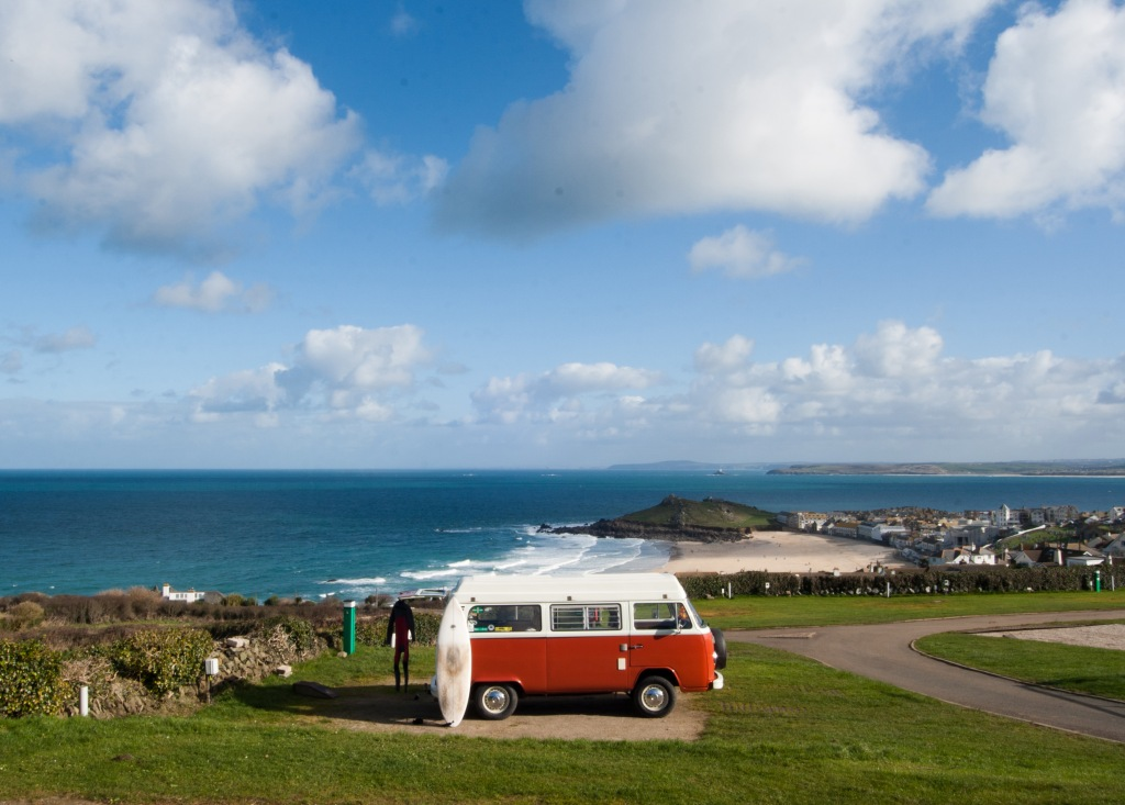Classic VW Campervan at a coastal campsite overlooking the sea