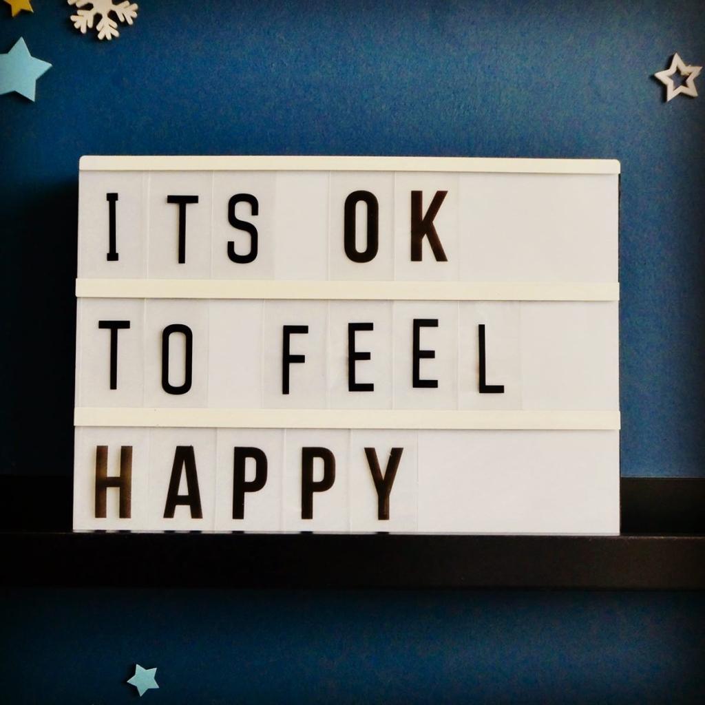 It's OK to feel happy Lightbox Quote