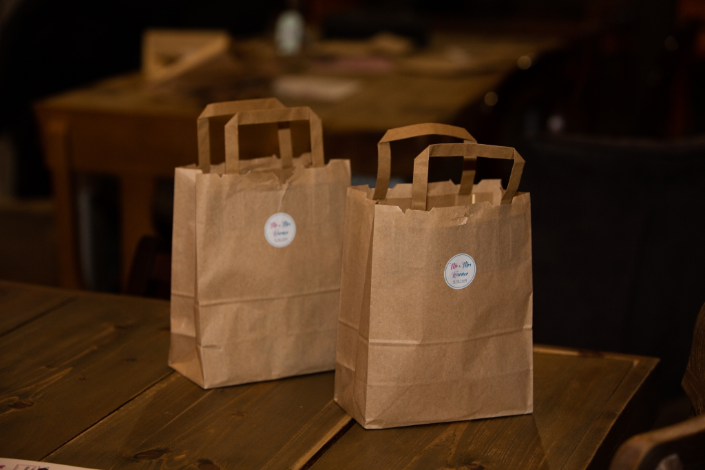 A recycled brown gift bag full of eco-friendly goodies